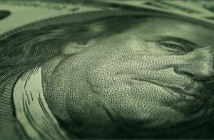 stock-footage-fly-over-and-close-up-a-hundred-dollar-bills-loop