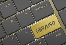 Klawisz z napisem GBP/USD na klawiaturze komputerowej