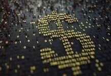Symbol dolara amerykańskiego stworzony z żółtych liczba na czarnym tle