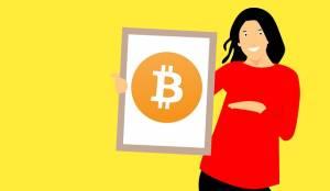 kobieta trzymające plakat Bitcoin